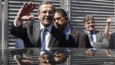 Antonis Samaras (L) waves as he leaves the International Trade Fair of Thessaloniki