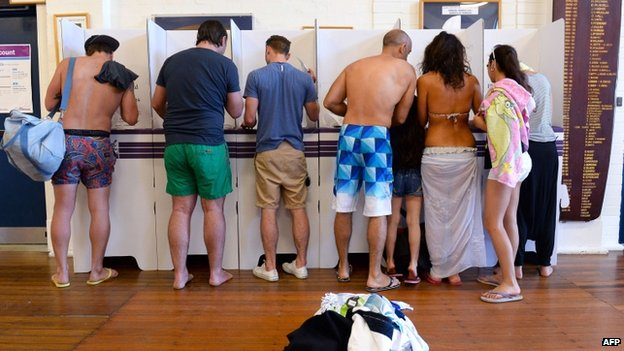 Australians cast their ballot in Sydney's Bondi beach on 7 September 2013