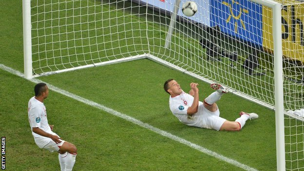 John Terry clears a shot from Ukraine's Marko Devic from under his crossbar during England's 1-0 win at Euro 2012