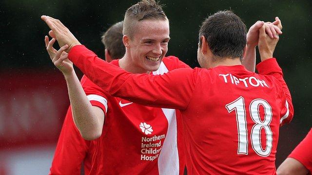 Goal scorers Aaron Burns and Matthew Tipton celebrate Linfield's win over Ards