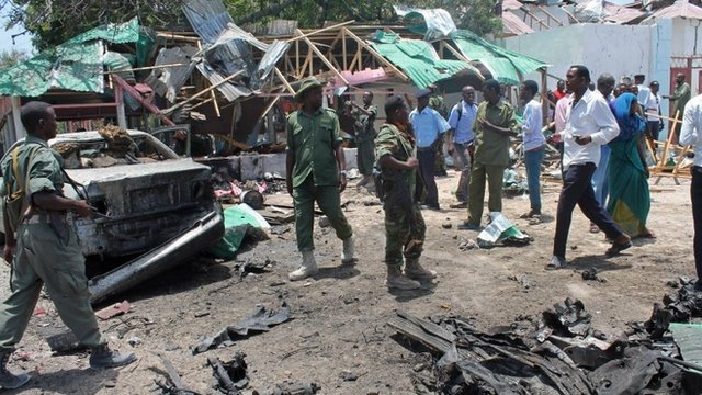 Somali soldiers gather near The Village restaurant following blast