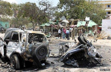 Shattered vehicles near the site of the bombing in Mogadishu, 7 September