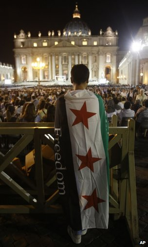 A man draped in a Syrian flag attends the peace vigil at the Vatican, 7 September