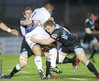 Glasgow Warriors players Chris Fusaro and Pat MacArthur team up to halt the run of Blues prop Taufa'ao Filise.