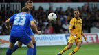 Newport County's Christian Jolley has a shot on goal during his side's League Two game at home to Mansfield Town.