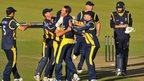 Michael Hogan is congratulated by team-mates after bowling Chris Wood off the last ball of Hampshire's innings to confirm Glamorgan's place in the YB40 final at Lord's
