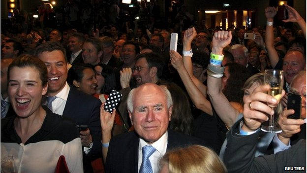 John Howard smiles as Australia's leader Tony Abbott claims victory at an election night function in Sydney, 7 September