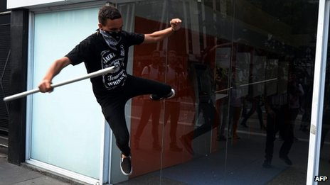 Sao Paulo activists breaks bank window