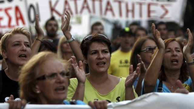 Protesters shout slogans during a rally in Thessaloniki,