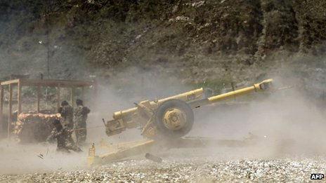 Afghan National Army soldiers test fire a Howitzer gun during a training session in Kunar