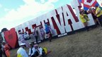 Festival goers at Bestival sign