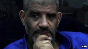 Handout picture from the Libyan National Guard shows Abdullah al-Senussi after his arrival at a high security prison facility in Tripoli