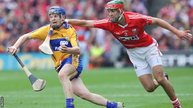 Clare's Padraig Collins is challenged by Stephen McDonnell in the decider