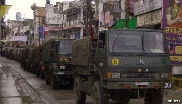 Indian army vehicles patrol on a deserted road during a curfew in Muzaffarnagar, in the northern Indian state of Uttar Pradesh September 8, 2013