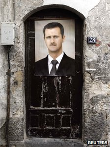 A portrait of Syria's President Bashar al-Assad is affixed on a door in old Damascus