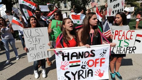 Demonstrators participate in a protest against military intervention in Syria on 7 September 2013 in Indianapolis, US