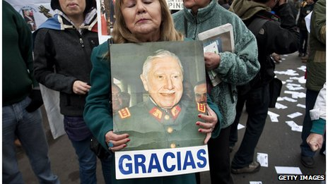 A woman holds a sign thanking Gen Augusto Pinochet at a demonstration on 10 June 2012