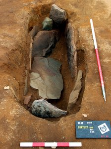 Excavated grave -- The remains found in the grave are now being analysed