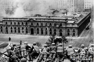 A group of soldiers overlook the presidential palace in Santiago on 11 September 1973 - the day of the coup
