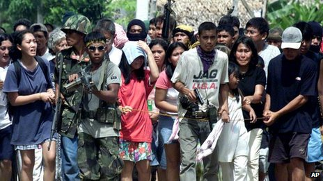 File photo: the MNLF uses hostages as a human shield in Zamboanga city on 27 November 2001