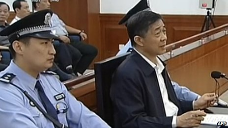 This screen grab taken from state television CCTV footage broadcast on 25 August  2013 shows ousted Chinese political star Bo Xilai (R) speaking in the courtroom as he stands trial at the Intermediate People's Court in Jinan, in eastern China's Shandong province