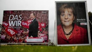Election campaign posters of German Chancellor Angela Merkel and her challenger of the Social Democratic Party, Peer Steinbrueck