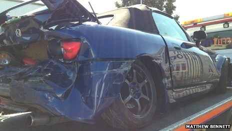 The damaged Honda sports car