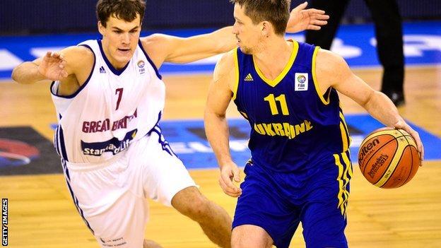 Ukraine's Dmytro Zabirchenko with Great Britain's Devon Van Oostrum