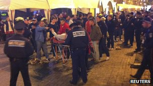 England fan on stretcher