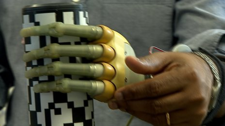 Robot hand holding cup