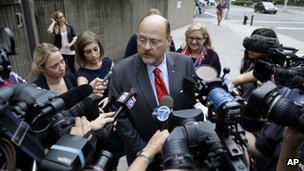 Republican mayoral hopeful Joe Lhota talks with reporters as he arrives to his polling station during the primary election in New York, 10 September 2013