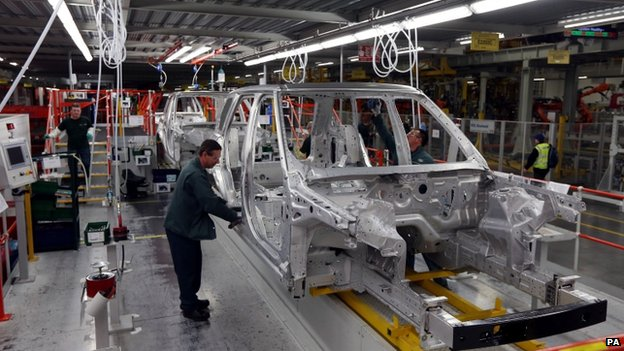 A worker building a Range Rover at the Solihull plant
