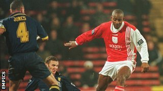 Dele Adebola, in his days at Crewe, prepares to sidestep future Hollywood star Vinny Jones