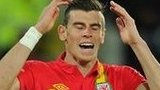 Gareth Bale holds his head in despair after missing a chance against Serbia