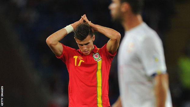 The world's most expensive player Gareth Bale looks despondent as Wales are beaten by Serbia in Cardiff