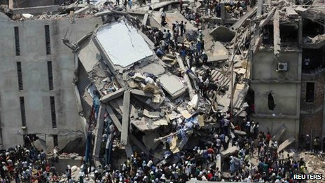 People try to rescue garment workers trapped under the rubble of the collapsed Rana Plaza building