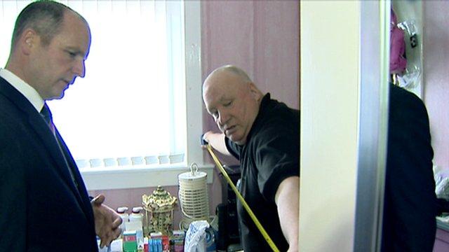 Davie Nelson measures the room