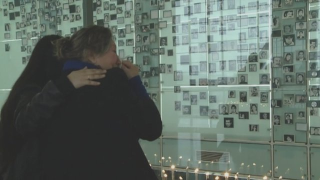 Tearful relatives look at photos of lost loved ones