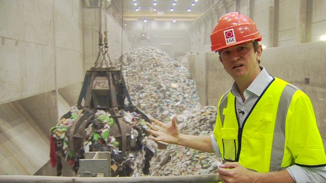 Matthew Price with rubbish in background