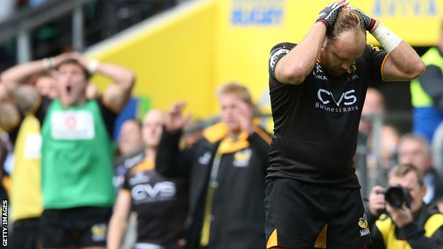 Wasps fly-half Andy Goode holds his head after his last-gasp conversion attempt hits the post