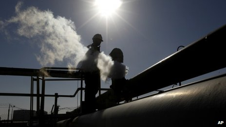 An oil worker, works at a refinery inside the Brega oil complex, in Brega, eastern Libya - File photo
