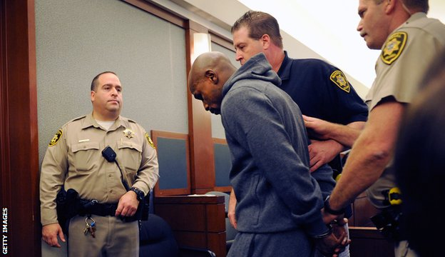 Mayweather is led away after being sentenced to 90 days in prison in 2011