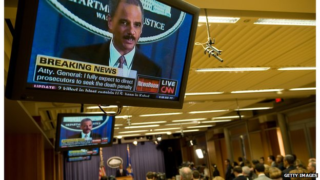 Television screen showing an image of Attorney General Eric Holder