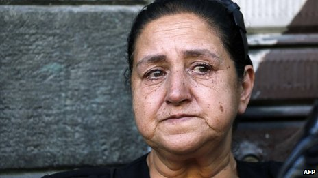 A woman weeps at the funerals for three Maaloula residents in Damascus (10 September 2013)