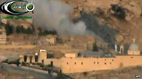 An online video from a rebel group shows smoke rising from the St Sarkis monastery after shelling (6 September 2013)
