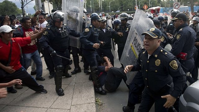 Teachers and police clash during a protest