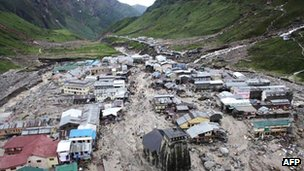 In this photograph taken on June 18, 2013, the Kedarnath Temple (C, foreground) is pictured amid flood destruction in the holy Hindu town of Kedarnath, located