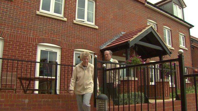 Elderly couple leaving retirement home