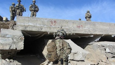 ISAF troops checking for road side bombs in Afghanistan
