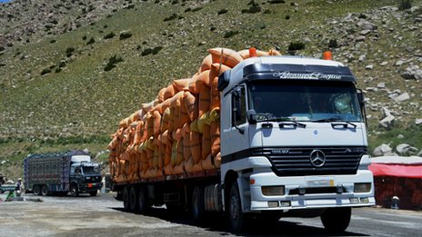 Lorries transporting goods on an Afghan highway